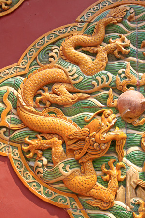 lifelike: BEIJING - MAY 23: Glazed tile dragon shaped puzzles in the Beihai Park, on may 23, 2014, Beijing, China  Editorial