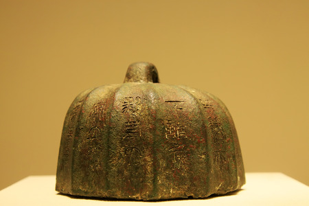 counterpoise: CHINA - QIN DYNASTY (221-206 BC) : Melon shaped Bronze Weight, Qin Dynasty (221-206 BC), collection in the China national museum, Beijing, China.  Editorial