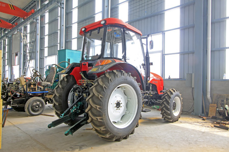 LUANNAN COUNTY - AUGUST 16: large tractor in storage workshop, on august 16, 2014, Luannan County, Hebei Province, China