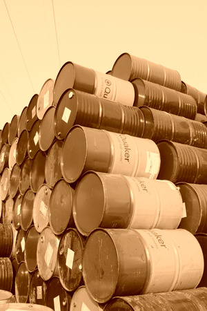 gallons: oil drums stacked together in a yard, north china