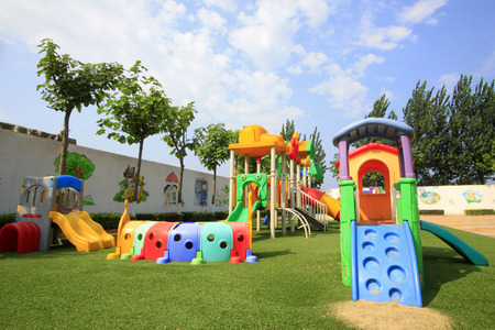 LUANNAN COUNTY - AUGUST 15: Entertainment facilities in a kindergarten, on august 15, 2014, Luannan County, Hebei Province, China Sajtókép