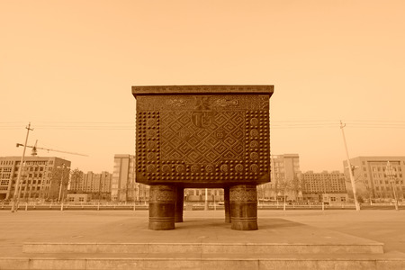 cultural artifacts: FUCHENG - DECEMBER 5: A large Chinas Tripod, carved above one hundred happiness words, on december 5, 2013, fucheng, hebei province, China.