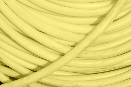 crimping: white plastic pipe stacked toghter at a construction site Stock Photo