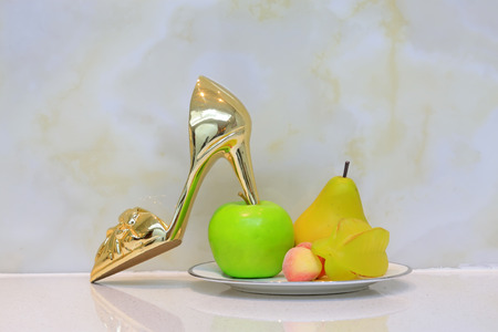 meticulous: Animal model ornaments and high heels, closeup of photo