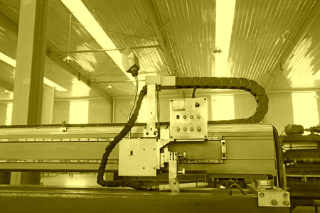 The numerically-controlled machine tool and control device in the production line, in a solar equipment production workshop on december 22, 2013, tangshan, china.