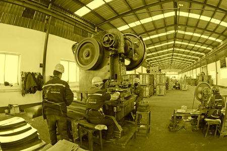 blanking: TANGSHAN - DECEMBER 20: Blanking workshop production line, in a manufacturing enterprise, on December 20, 2013, tangshan city, hebei province, China. Editorial