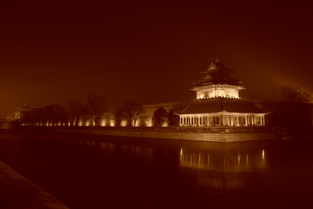 turrets: BEIJING - DECEMBER 22: The Northwest turrets of the Forbidden City at night, on december 22, 2013, beijing, china. Editorial