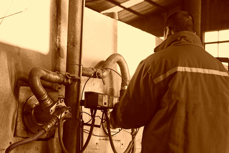 co operating: TANGSHAN - DECEMBER 20: The worker was operating gas stove, in a steel shovel manufacturing co., LTD., on December 20, 2013, tangshan city, hebei province, China. Editorial