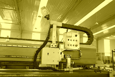 TANGSHAN - DECEMBER 22: The numerically-controlled machine tool and control device in the production line, in a solar equipment production workshop on december 22, 2013, tangshan, china.