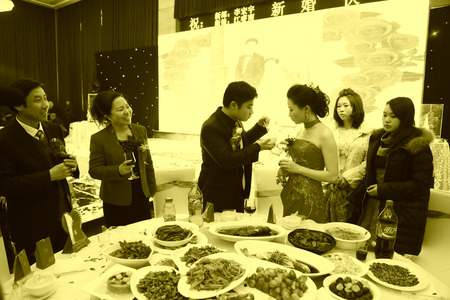wedding customs: LUANNAN COUNTY - DECEMBER 29: The groom fed food to the bride, traditional customs in chinese wedding, on december 29, 2013, Luannan County, Hebei Province, China. Editorial