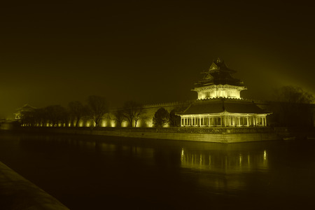 turrets: BEIJING - DECEMBER 22: The Northwest turrets of the Forbidden City at night, on december 22, 2013, beijing, china. Stock Photo