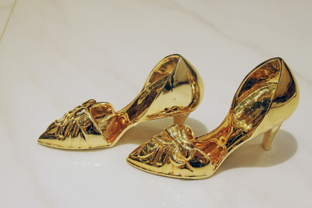 meticulous: high-heeled shoes on the ceramic tile, closeup of photo