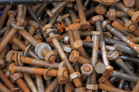 castings: oxidation rusty bolts, closeup photo