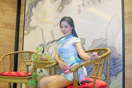 cane chair: TANGSHAN CITY - SEPTEMBER 13: Beauty model sitting in cane chair, On September 13, 2014, Tangshan City, Hebei Province, China Editorial