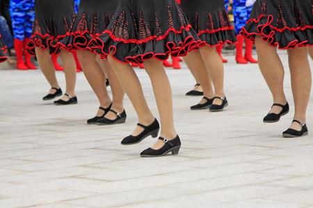 crus: black skirt and black shoes, closeup of photo