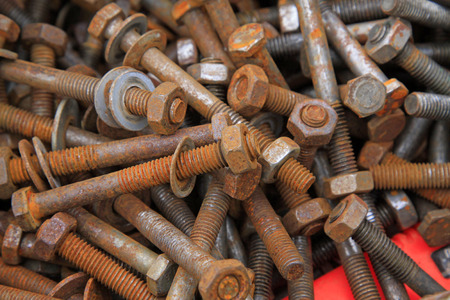 castings: oxidation rusty bolts, closeup of photo