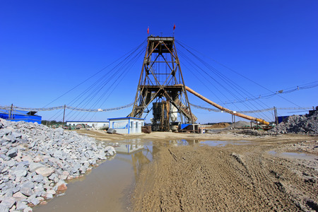 solid wire: LUANNAN COUNTY - OCTOBER 13: Drilling derrick in MaCheng iron mine, on october 13, 2014, Luannan County, Hebei Province, China
