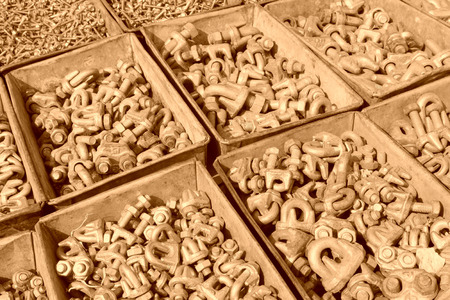 fasteners: metal parts and fasteners in a iron box, closeup of photo