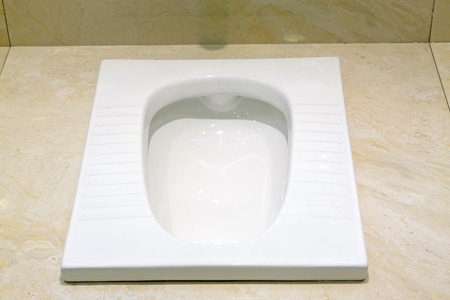 Ceramic squat toilets, closeup of photo