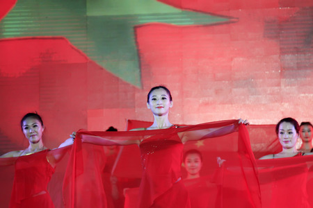 national day: LUANNAN COUNTY - SEPTEMBER 27: dance performance at the National Day party, on september 27, 2014, Luannan County, Hebei Province, China Editorial