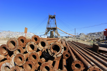 solid wire: LUANNAN COUNTY - OCTOBER 13: Drilling derrick and steel pipe in MaCheng iron mine, on october 13, 2014, Luannan County, Hebei Province, China