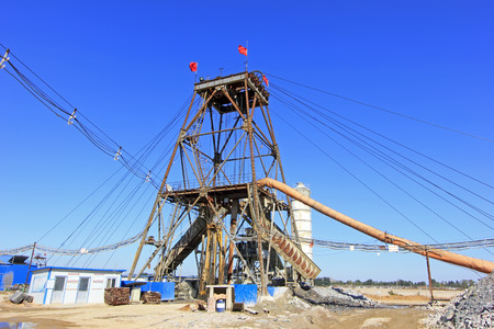 disorderly: LUANNAN COUNTY - OCTOBER 13: Drilling derrick in MaCheng iron mine, on october 13, 2014, Luannan County, Hebei Province, China