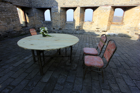 round chairs: CHENGDE CITY -  OCTOBER 19: Round table and chairs in jinshanling Great Wall, on october 19, 2014, Luanping County, Hebei Province, China