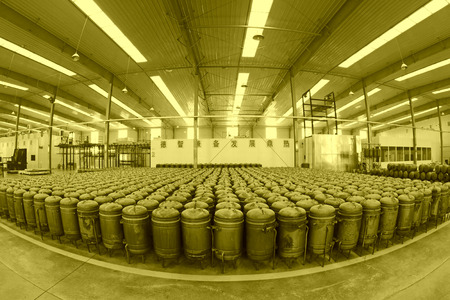 solar equipment: TANGSHAN - DECEMBER 22: The pressure tank put in a warehouse workshop, in a solar equipment production workshop on december 22, 2013, tangshan, china.