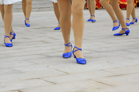 crus: White dress and blue shoes, closeup of photo Stock Photo