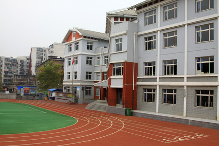 hebei province: CHENGDE CITY -  OCTOBER 20: Elementary school playground and building landscape architecture, on october 20, 2014, Chengde City, Hebei Province, China