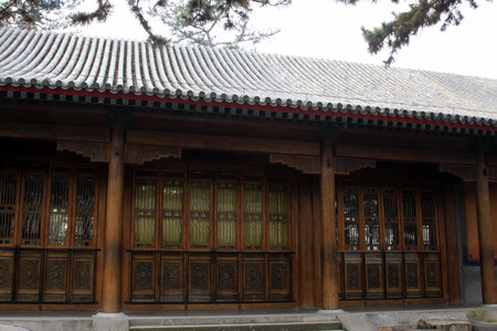 wood pillars: Chinese traditional style wooden windows lattice and column, closeup of photo