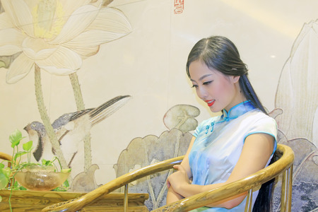 cane chair: TANGSHAN CITY - SEPTEMBER 13: Beauty model sitting on cane chair, On September 13, 2014, Tangshan City, Hebei Province, China