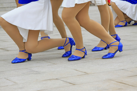 crus: White dress and blue shoes, closeup photo