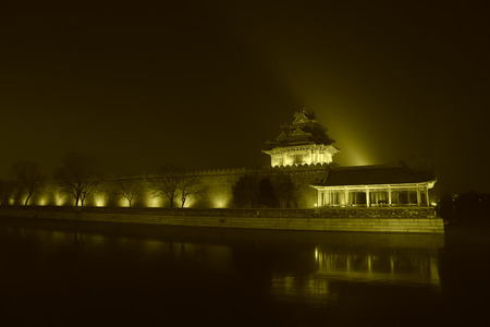 moat wall: BEIJING - DECEMBER 22: The Northwest turrets of the Forbidden City at night, on december 22, 2013, beijing, china. Editorial