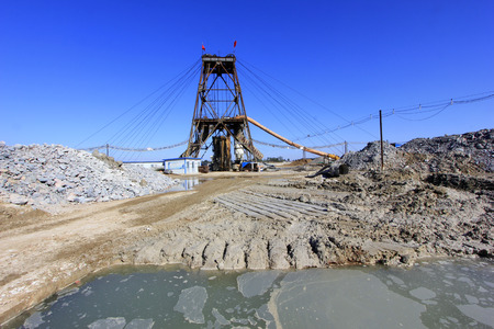 accumulation: LUANNAN COUNTY - OCTOBER 13: Drilling derrick and sewage pool in MaCheng iron mine, on october 13, 2014, Luannan County, Hebei Province, China Editorial