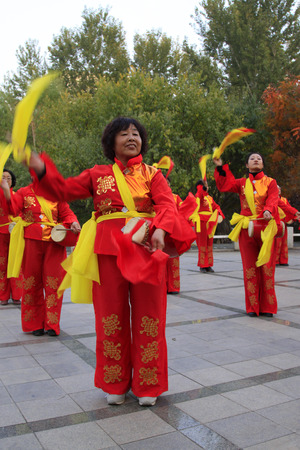 hebei province: CHENGDE CITY -  OCTOBER 20: Women waist drum performances in the park, on october 20, 2014, Chengde City, Hebei Province, China