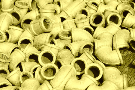 Metal plumbing pipe fittings piled up together