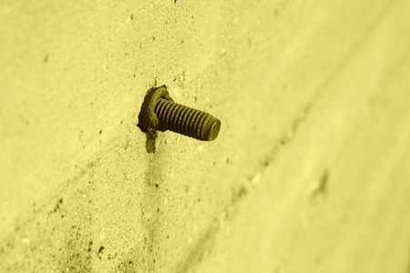 tighten: tighten bolts rust on concrete walls, closeup of photo