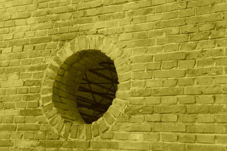 restore ancient ways: air hole on the wall in a factory Stock Photo
