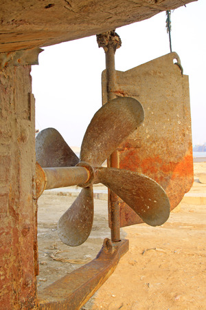 impeller: oxidation rusty fishing boat propeller, closeup of photo Stock Photo