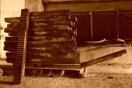 sludge: giant screw die full of sludge piled up together