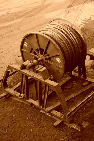 idle: idle steel wire rope drum in a factory Editorial