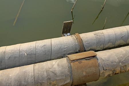 Old pipeline, closeup of photo