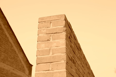 restore ancient ways: red brick wall under the blue sky