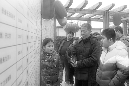 quizzes: LUANNAN COUNTY - FEBRUARY 14: Spring Festival riddles scene during Chinese Lunar New Year, February 14, 2014, Luannan County, Hebei Province, China. Editorial
