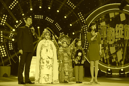 liu: LUANNAN COUNTY - JANUARY 6: The CCTV opera channel host Zhao Baole and liu chang and actors on the stage, in the ChengZhaoCai grand theater, January 6, 2014,luannan county, hebei province, china. Editorial