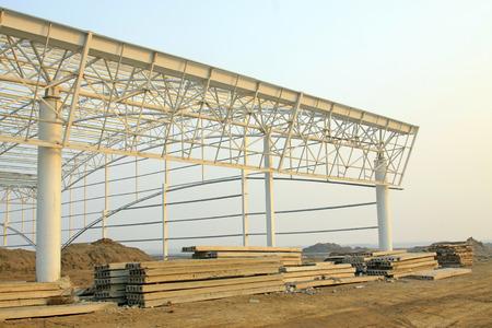 Factory workshop steel structure truss and precast concrete panel, closeup of photo