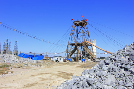 'rock drill': LUANNAN COUNTY - OCTOBER 13: Drilling derrick in MaCheng iron mine, on october 13, 2014, Luannan County, Hebei Province, China