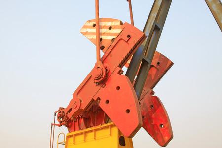 crank: Crank balanced beam pumping unit crank balance block, closeup of photo Stock Photo