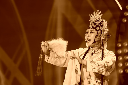 stage props: LUANNAN COUNTY - JANUARY 4: The female role in Chinese opera on the stage, in the ChengZhaoCai grand theater, January 4, 2014,luannan county, hebei province, china. Editorial